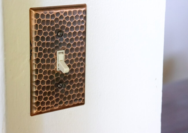 hammered copper light switch cover to match farmhouse sink
