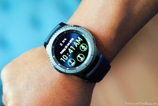 MobileHelp Smart Watch on wrist showing home screen and clock