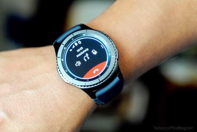 MobileHelp Smart Watch on wrist showing emergency call screen