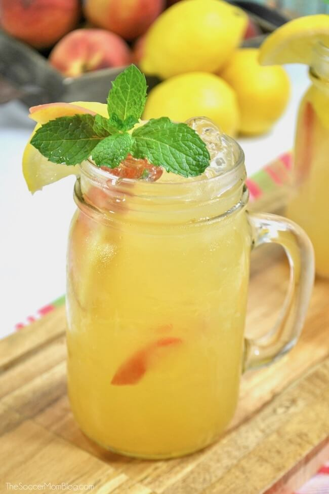 glass mug of peach lemonade with mint