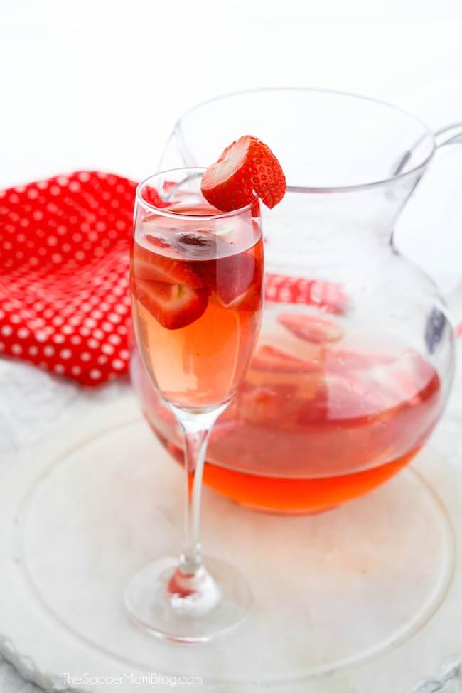 Pitcher of strawberry bellinis white background