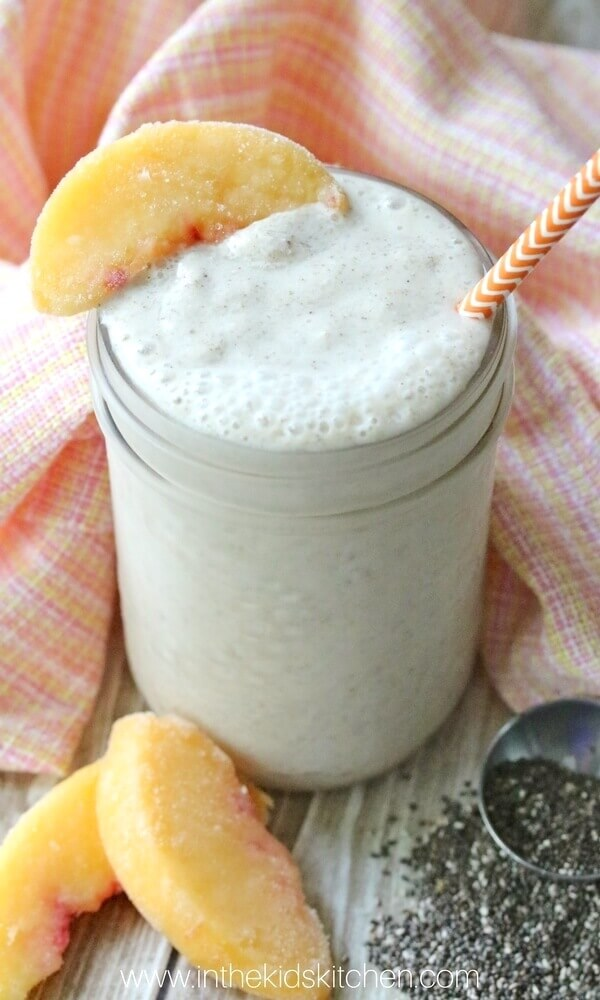 creamy peach smoothie in mason jar