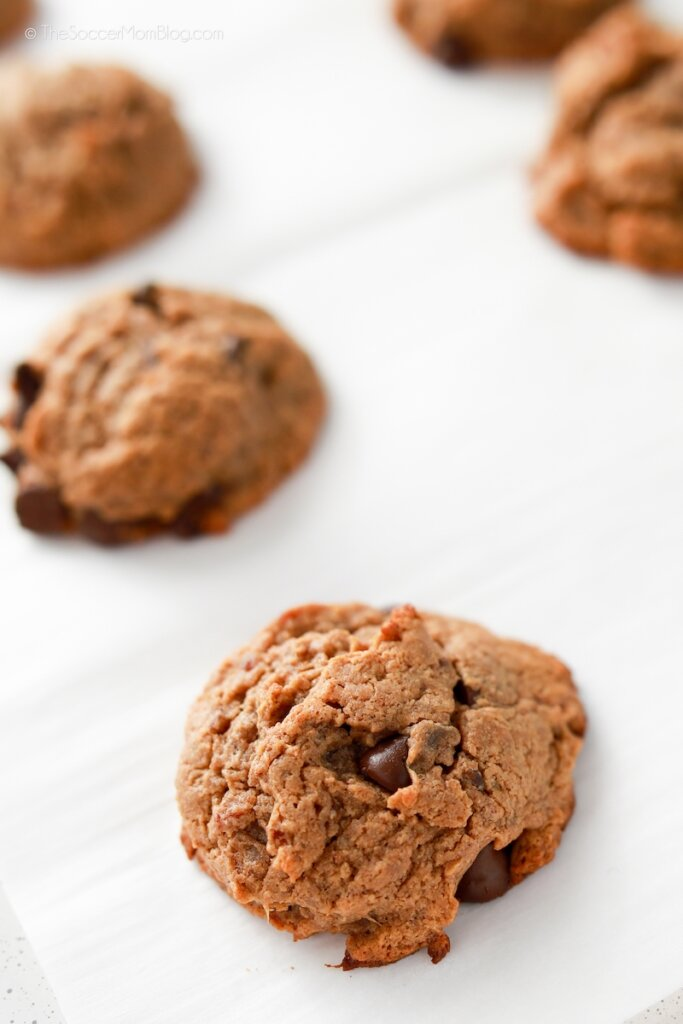 freshly baked flourless chocolate chip cookies on parchment paper