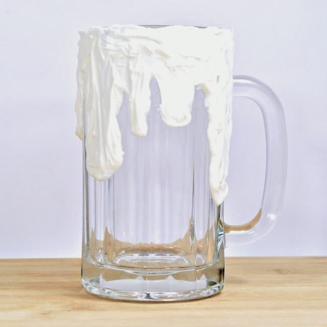 Glass mug with frosting to make a freak shake