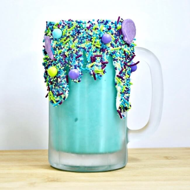 Glass mug decorated with mermaid sprinkles
