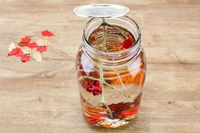 making autumn sensory bottle with a mason jar
