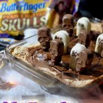Graveyard Cake is a spooktacular Halloween party recipe made with rich brownie, creamy marshmallow, and crunchy Butterfinger Peanut Butter Skulls.