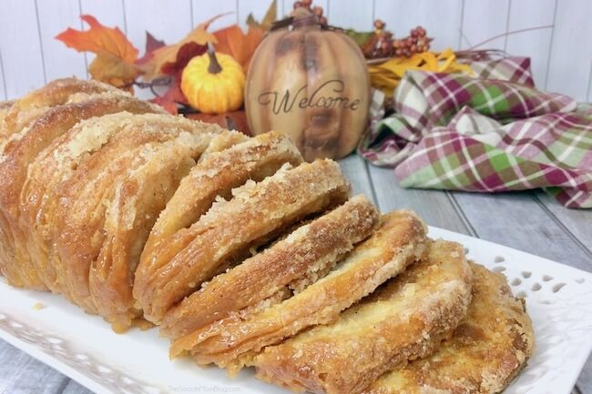 Flaky from-scratch biscuits layered with pumpkin pie filling - need we say more? This Pumpkin Pie Pull Apart Bread is to die for!!
