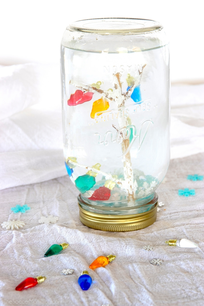 Kids will love this eye-catching Christmas Snow Globe with twinkling lights and falling snow! Click for easy video tutorial!