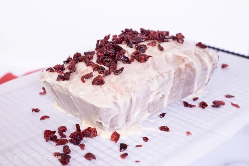icing quick bread with vanilla glaze and dried cranberries