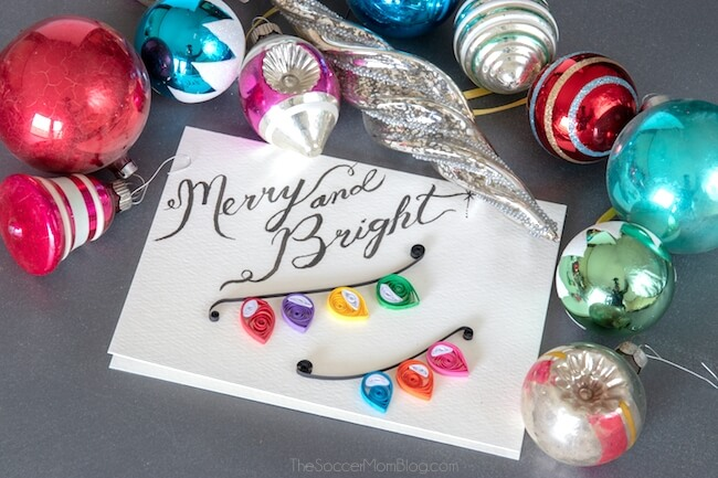 A simple, yet beautiful Quilled Christmas Lights Card that is easy enough for beginners to make. Step-by-step video and photo tutorial inside.