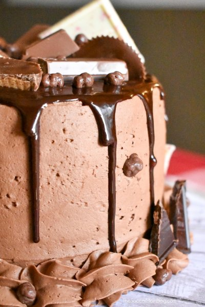 The most over-the-top decadent dessert ever!! This Candy Bar Cake is a chocolate lover's dream come true! Click for recipe!