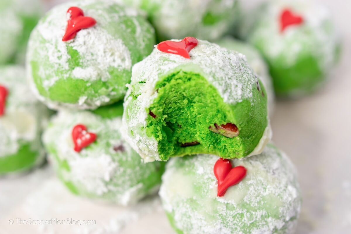bright green Grinch Christmas cookies on plate
