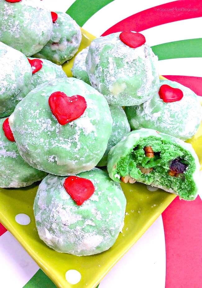 green snowball cookies for Christmas, with red heart sprinkles