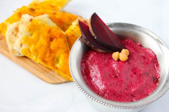 Stunning and healthy! This Roasted Beet Hummus recipe is a bright update on a classic Mediterranean appetizer.
