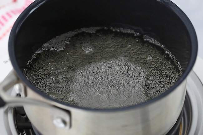 making champagne extract in saucepan