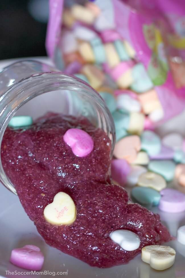 This edible conversation heart slime is super wiggly and jiggly and it's taste-safe! Such a fun Valentine's Day sensory activity for kids!