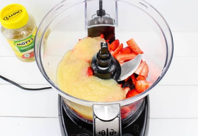 Applesauce and strawberries in food processor