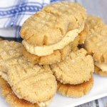 "Soft peanut butter cookies filled with luscious peanut butter cream — these Homemade Nutter Butter cookies might just be better than the ""real"" thing!"
