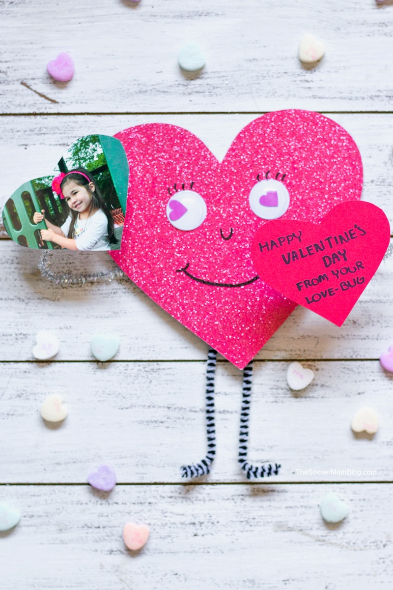 3D love bug Valentine craft surrounded by candy hearts