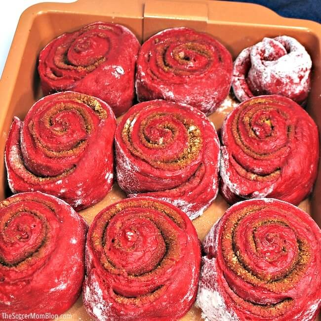 close up of red velvet cinnamon rolls baking