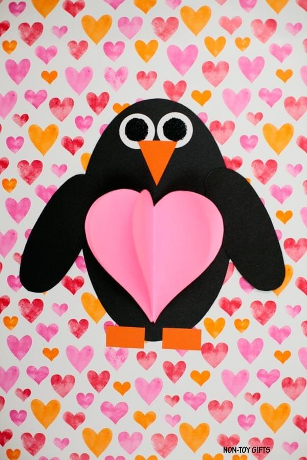 paper penguin craft with heart shaped belly