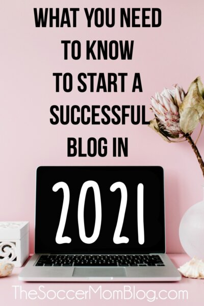 "open laptop with pink background and text overlay ""What You Need to know to start a successful blog in 2021"""