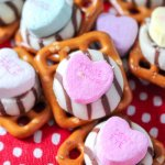 A quick and easy Valentine's Day party snack that's ready in minutes! These cute Valentine Pretzel Treats are fun for kids to make and perfect gifts for teachers, family and friends.