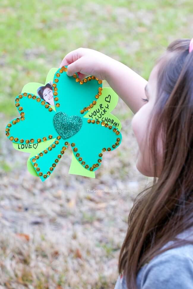 This spinning kid-made shamrock photo card is a cute and easy St. Patrick's Day greeting card! A fun project to make at home or in the classroom with simple craft supplies.