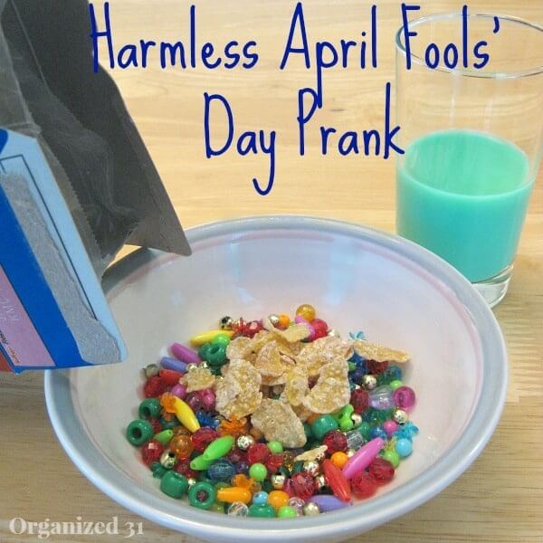 beads and LEGO pieces in cereal bowl with green milk for April Fool's Day