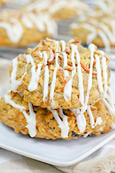 carrot cake oatmeal cookies stacked on a plate