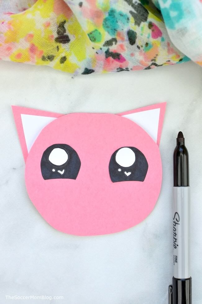 drawing eyes on a kitty cat shaped card