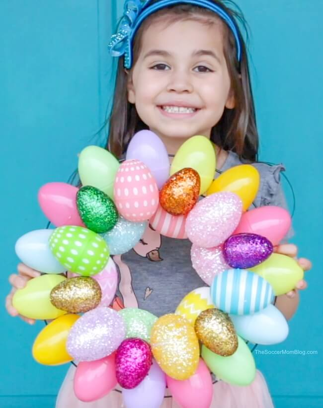 A quick & easy Easter Egg Wreath that anyone can make! Add a festive touch of Spring to your front doors in minutes with two different versions of this Easter craft.