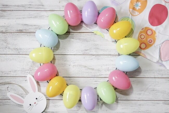 plastic eggs glued to a wire wreath frame