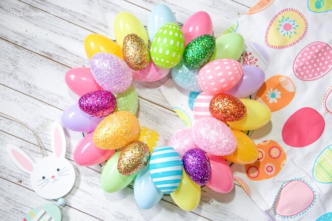 A quick & easy Easter Egg Wreaththat anyone can make! Add a festive touch of Spring to your front doors in minutes with two different versions of thisEaster craft.
