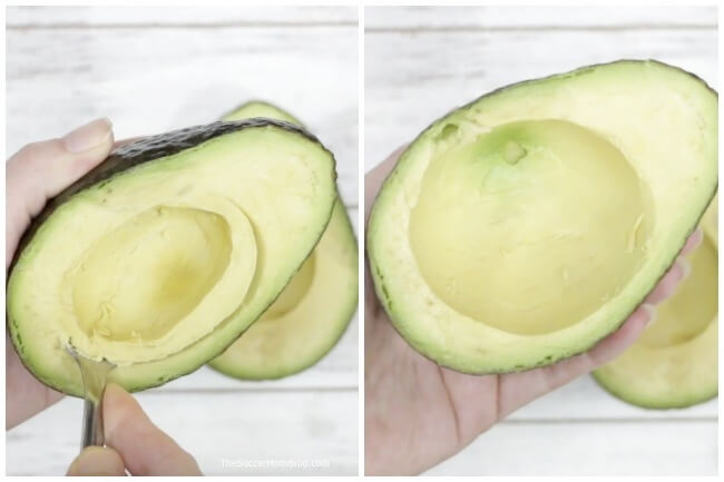 Scooping out an avocado to stuff