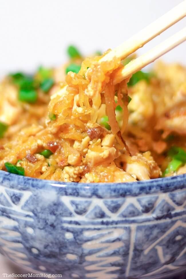 chopsticks picking up spaghetti squash pad thai