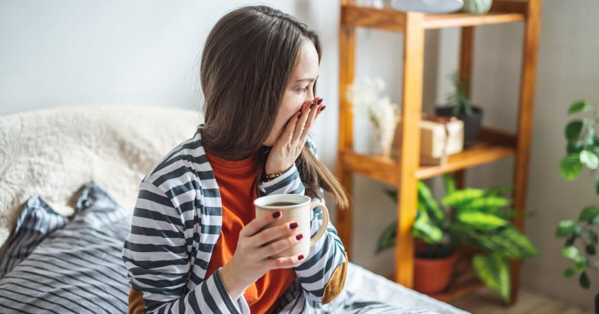 yawning mom with coffee