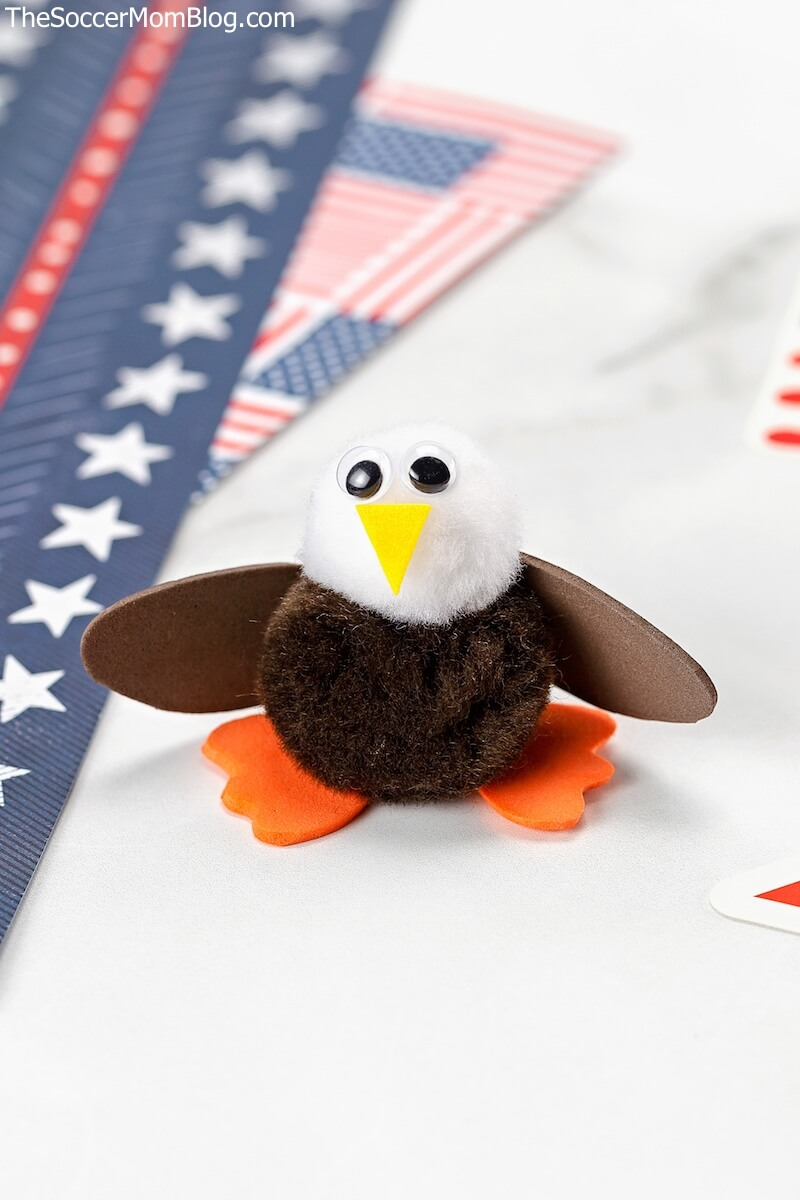 bald eagle made from pom-poms with red white and blue background