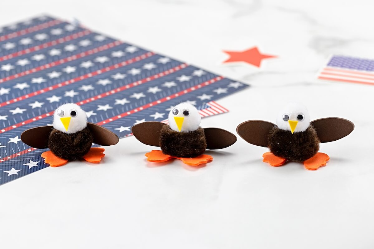 three bald eagles made from pom-poms