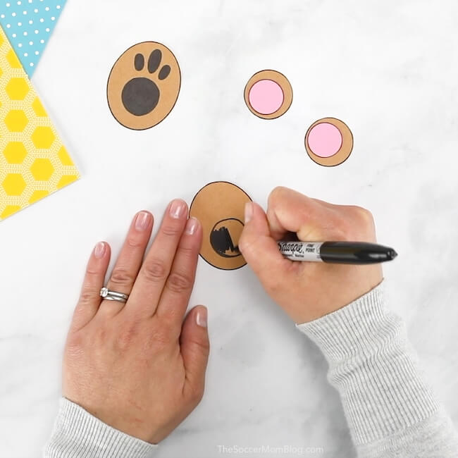 Drawing paws for a teddy bear craft