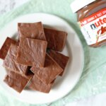 plate of rich chocolate hazelnut fudge and Nutella bottle