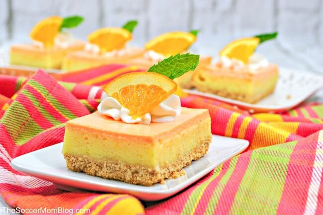 Just like the refreshing frozen treat, in cheesecake form! These delicious Orange Creamsicle Cheesecake Bars are the perfect summer dessert!