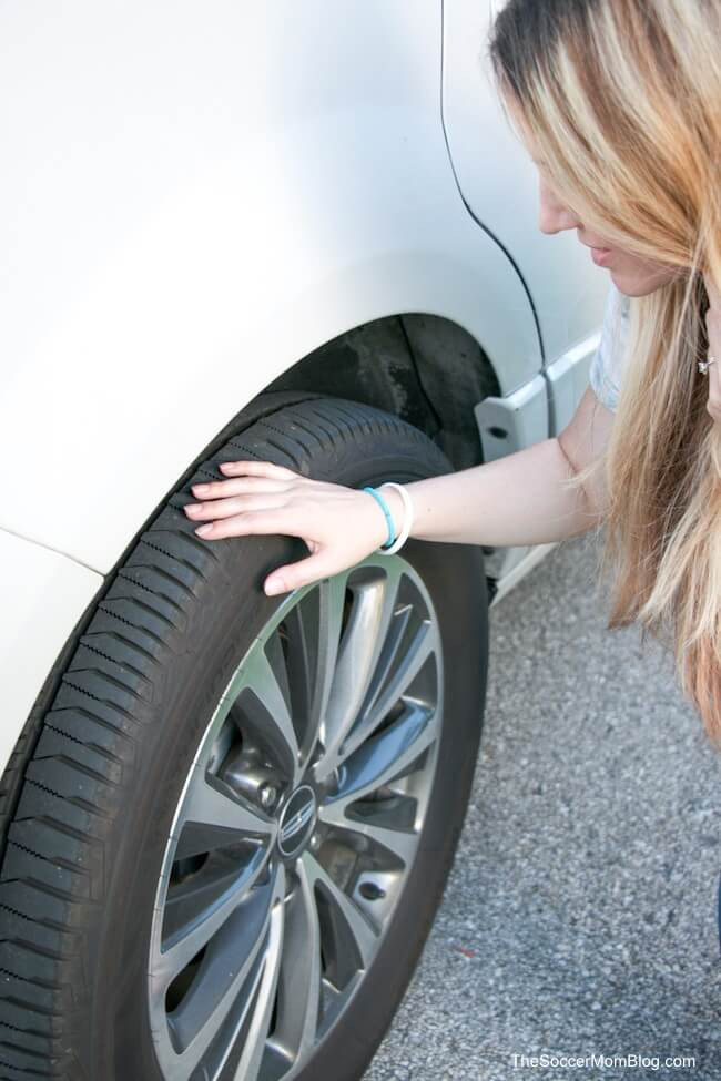 checking tire pressure for summer driving