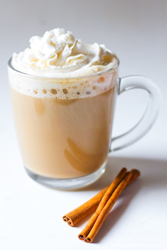 close up of cinnamon dolce latte in mug with cinnamon sticks