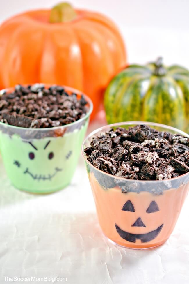 close up of Halloween decorated pudding cups