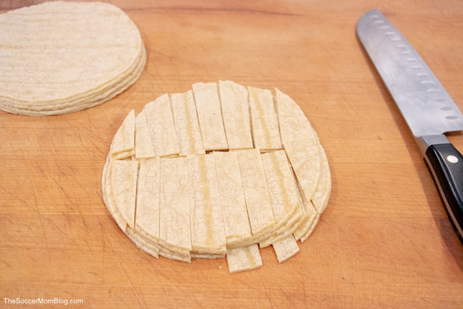 cutting corn tortillas into strips