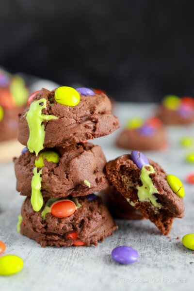 stack of Halloween cookies with oozing green frosting