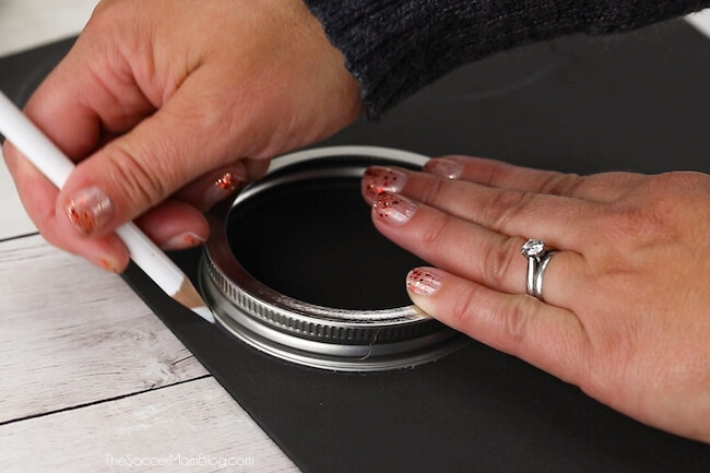 tracing circles on black craft foam