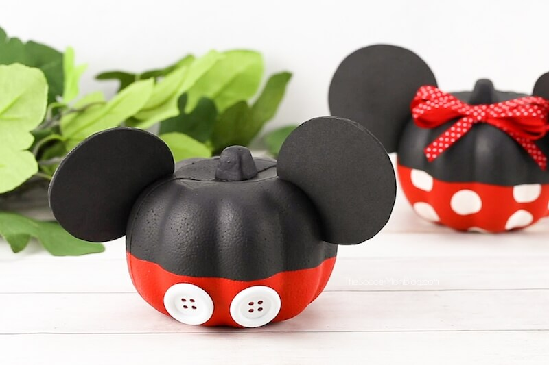 Mickey Mouse pumpkin with Minnie Mouse Pumpkin in background